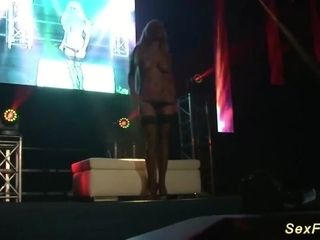 German big-boobed cougar on public stage