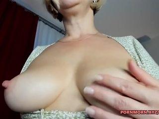 Blonde mature teasing her huge tits