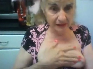 Hot mature lady reveals her big tits and her tight cunt in