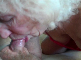 Naughty granny blowing her lover's hard cock