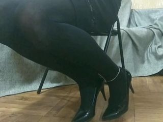Dressed in Short Skirt, Stockings and High Heels