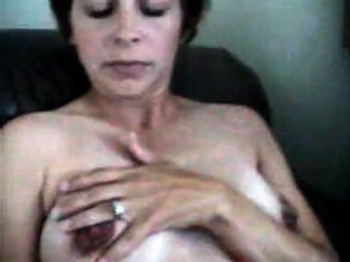 Mature gives a solo getting off and unwrapping lovemaking showcase