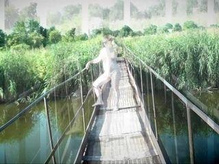 'Messalina Dressed in Sun. Outside Outdoor. Nude Milf walks by bridge River. Naturist Nudist Woman'