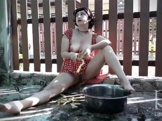 Retro maid prepares potatoes for dinner. Vintage performance. 2