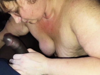 Mature slut giving oral to a big black cock