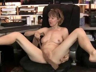 Slim, mature with natural tits is spreading up wide while masturbating in front of the camera