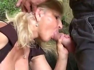Blonde granny banged hard outdoors by huge young cock in ass
