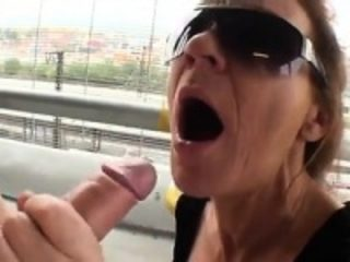 Adult girlfriend sucking penis in a parking lot