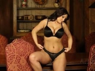 Beautiful brunette perfroms sexy striptease and exposes big natural breasts