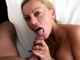 Chubby titted flaxen-haired housewife milf sucking coupled with rubs the brush Bristols