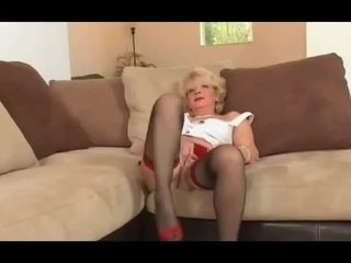 Older lady in stockings getting fucked by junior guy