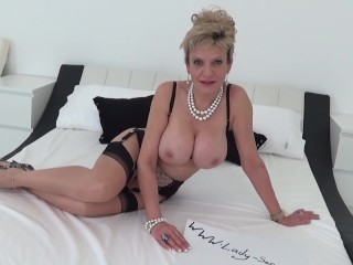 'Big titty blonde mature Lady Sonia loves to tease!'
