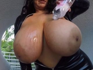 'Subrina Lucia spilling oil into her huge natural boobs'