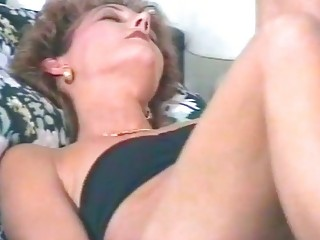 Kinky milf masturbates and uses big toy dick